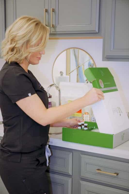 image of Ashley McFarland preparing chemical peel solution