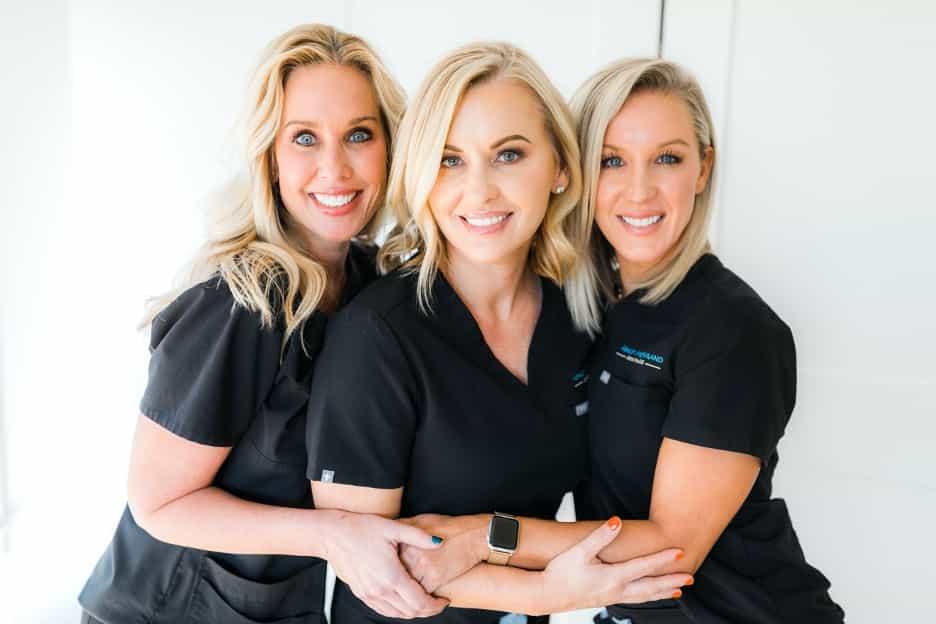 image of three blonde women hugging at med spa