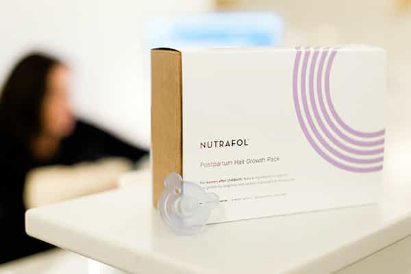image of nutrafol postpartum supplements for hair loss in Ashley McFarland Aesthetics office